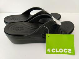 CROCS Black, with metal round accent Woman's Wedge Sz 9 NEW